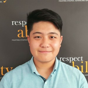 Thomas Noh is smiling in front of the Respectability banner
