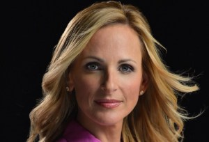 headshot of Marlee Matlin wearing a pink top