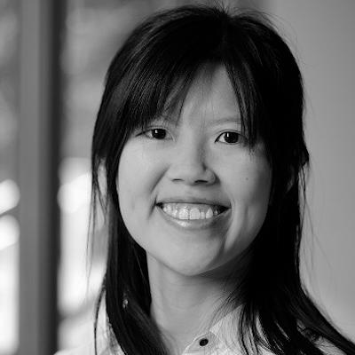 Clara Li Long Loh looking towards camera, smiling