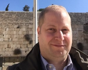 Eli Ovits in front of a wall in Israel