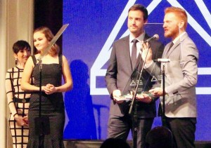 Scott Beck and Bryan Woods accepting their Media Access Award as Millicent Simmonds looks on