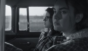 Kara Hayward and Liana Liberato sitting in a vehicle
