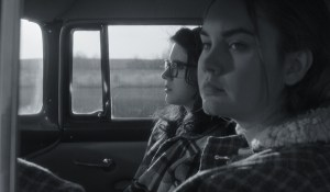 Kara Hayward and Liana Liberato sitting in a vehicle