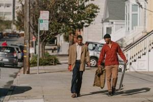 Jimmie Fails and Jonathan Majors walking down a sidewalk