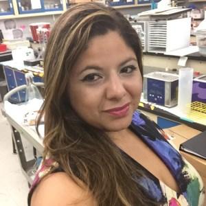 Kaliris Salas-Ramirez smiling in a lab classroom