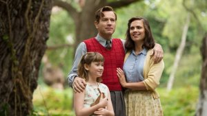 still from Christopher Robin movie showing parents and daughter