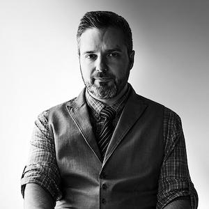 black and white headshot of David Renaud