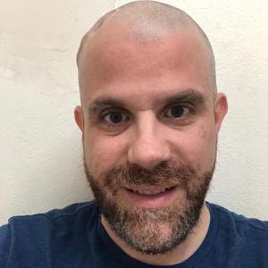 Michael Dougherty smiling headshot