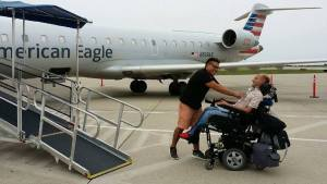 Lenny Larsen and his primary LVN Carlos Lopez outside an airplane smiling at each other