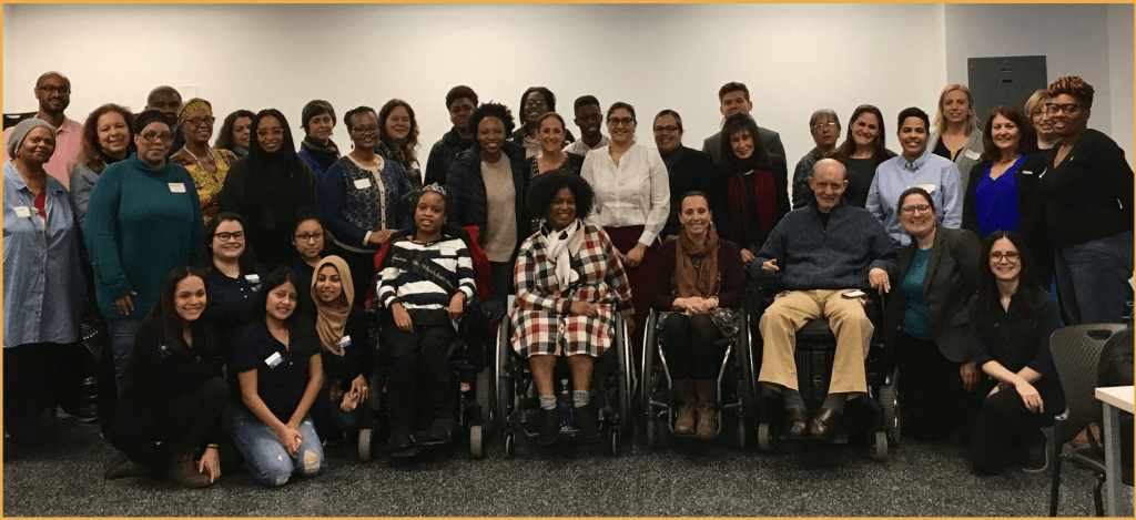 Attendees at training for mothers of students with disabilities smiling together