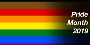 Pride flag with all colors of rainbow including black and brown. Text: Pride Month 2019