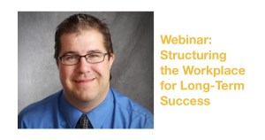 James Emmett smiling wearing a blue shirt and glasses in front of a grey backdrop. Text: Webinar: Structuring the Workplace for Long-Term Success