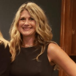 Michelle Krefft smiling wearing a sleeveless dress