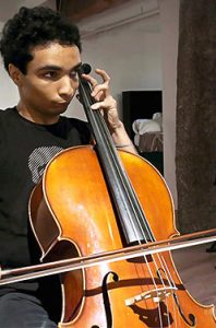 A young adult with autism playing the viola