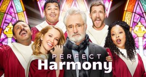 The cast of NBC's Perfect Harmony in red robes inside a church with stain glass windows. Logo for Perfect Harmony