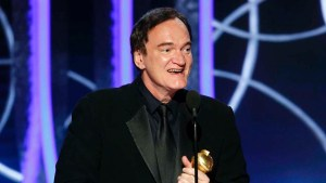 Quentin Tarantino accepts his award for Best Screenplay on stage at the Golden Globes