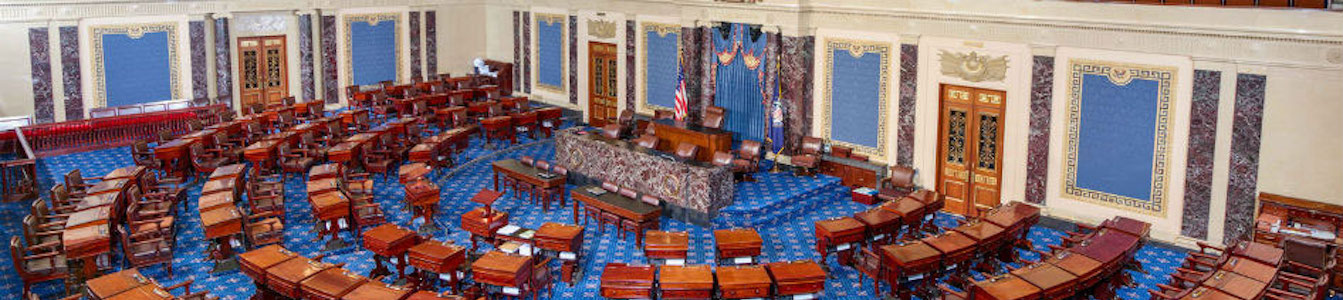 The U.S. Senate chamber, empty, from above.