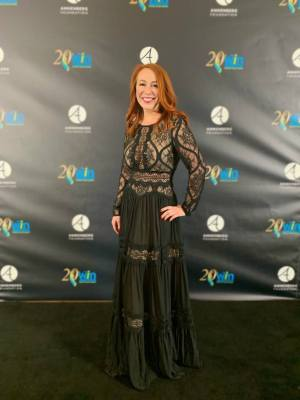 Gisselle Legere smiling outside of the 20th Women's Image Awards