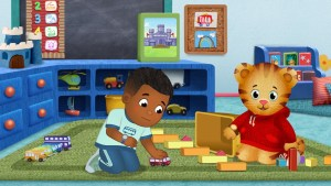 A scene from Daniel Tiger's Neighborhood with Max playing with toy trains