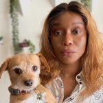 Cashmere Jasmine headshot holding her dog