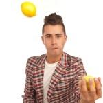 Ty Freedman headshot holding a lemon