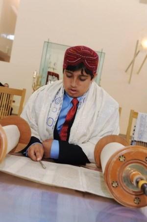 David Sharif reading from the torah in preparation for his bar mitzvah