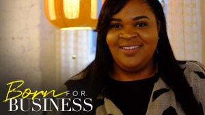 Qiana Allen smiling at home. Born For Business logo in bottom left