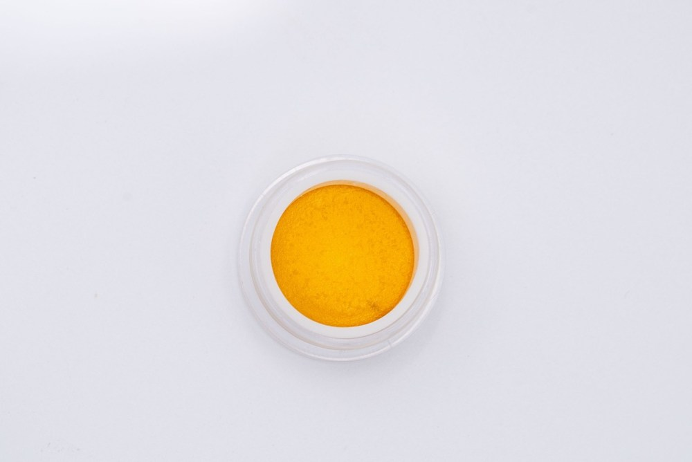 cinderella 99 orange concentrate in a round jar