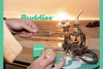Hands holding Buddies Brand Gelato Live Resin in front of dab rig
