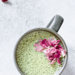 pandan cashew milk latte with rose petals