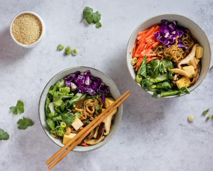 vegan ramen with tofu, mushrooms, bok choy, red cabbage, carrots, green onion