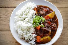 Rice, beef stew together with local vegetables
