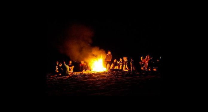 Tourists basking night fire at Chitimba Camp