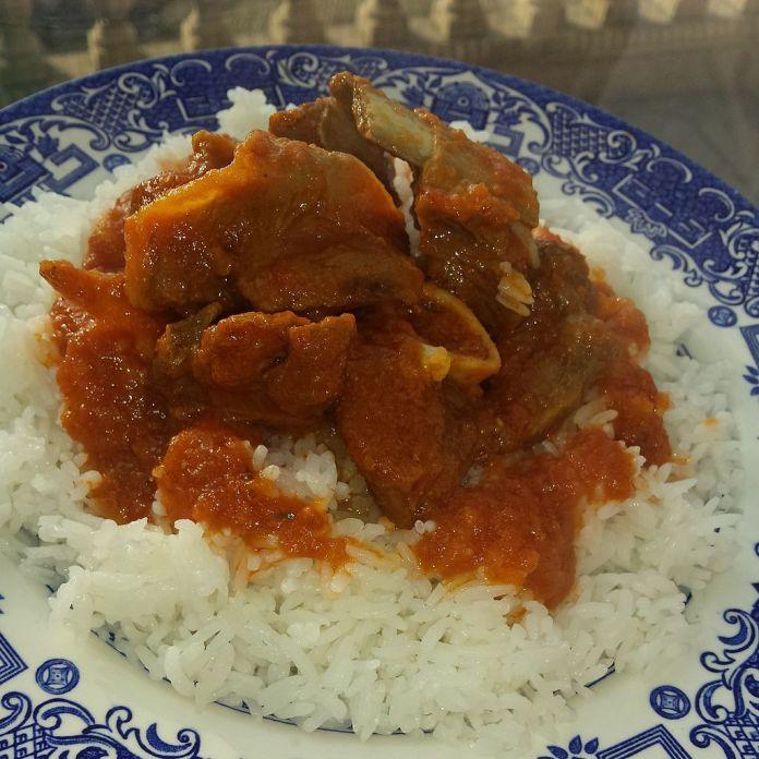 1024px Nigerian goat meat stew with jasmine rice