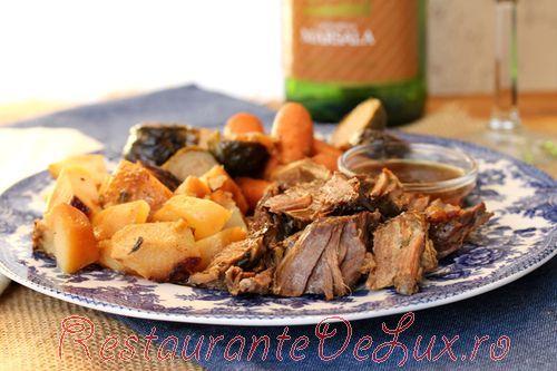 Cotlet de porc cu dovlecel si cartofi la cuptor