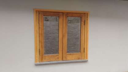 Restructuring of a door and a chestnut wood window