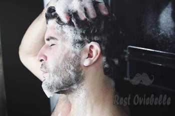 Man washing his hair.  best beard shampoo