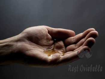 man hand with oil best pre-shave oils