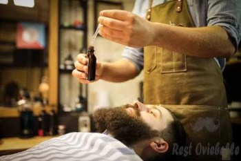 barber putting beard oil to client - beard oil s and pictures How Often Should You apply Beard Oil?