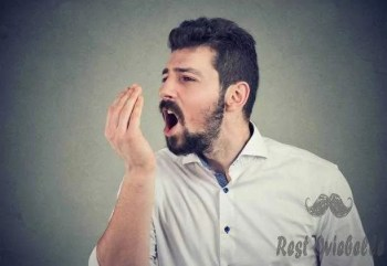 man doing a hand breath test best toothpaste for bad breath