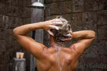 man washing hair in shower - thickening shampoo for men stock pictures royalty-free photos & images best thickening shampoo for men