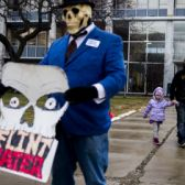 Natielee, 4, as they walk through pastactivists protest outside of City Hall to protest Michigan Gov. Rick Snyder's handling of the water crisis, Friday, Jan. 8, 2016 in Flint. Mich. (Jake May/The Flint Journal-MLive.com via AP) LOCAL TELEVISION OUT; LOCAL INTERNET OUT; MANDATORY CREDIT