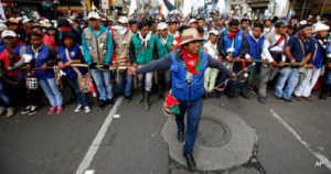 People participate in a peace march in Bogota, Colombia, Wednesday, Oct. 12, 2016. Thousands of rural farmers, indigenous activists and students marched in cities across Colombia to demand a peace deal between the government an leftist rebels no be scuttled. (AP Photo/Fernando Vergara)