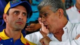 Opposition leader Henrique Capriles (L) during an anti-government rally with Henry Ramos Allup