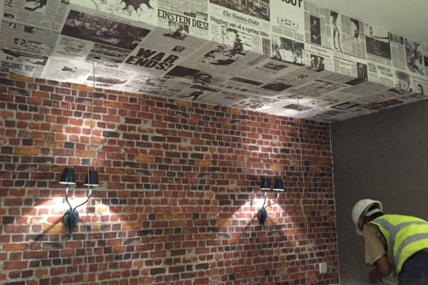 Brick and newspaper custom printed wallpaper - Billy G's