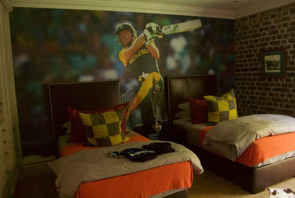 printed wallpaper depicting favourite cricket hero