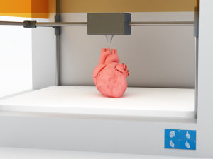 3d printing human body. 3d printed body parts, closeup view inside 3d printer.