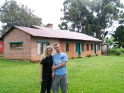 Michelle and Daniel stand in front of Carolyn Stultenburger's house where they were born.