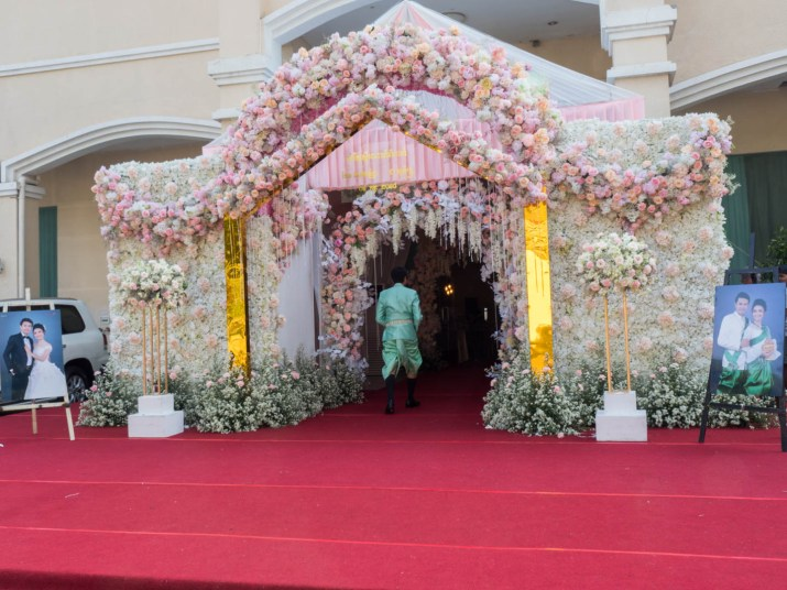 flowered entrance with wedding photos