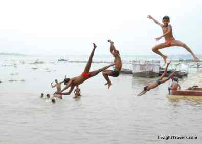 varanasi ganges young boys jumping into the ganges river